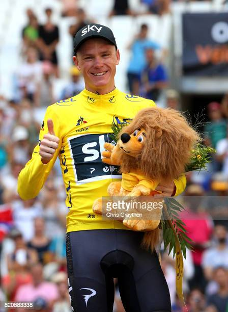 Chris Froome of Great Britain and Team Sky celebrates in the yellow jersey following stage twenty of Le Tour de France 2017 on July 22 2017 in...