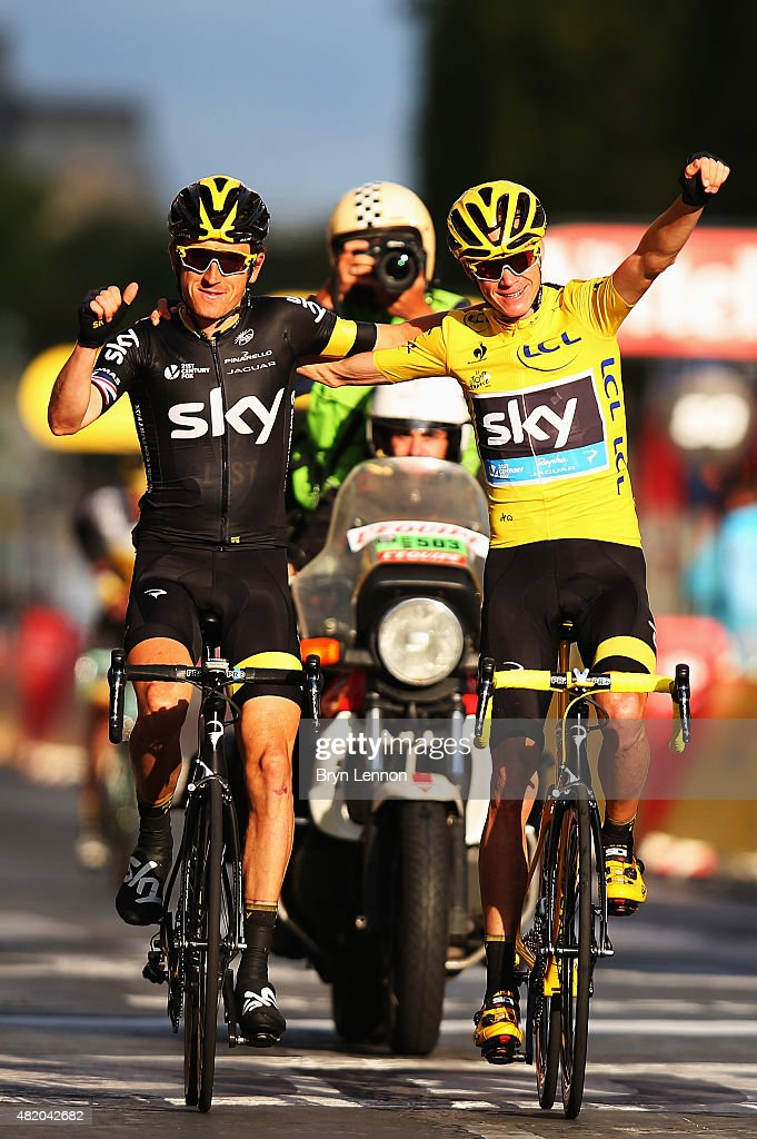 Chris Froome (R) of Great Britain and Team Sky celebrates overall victory with team mate Geraint Thomas (L) of Great Britain and Team Sky following the twenty first stage of the 2015 Tour de France, a 109.5 km stage between Sevres and Paris Champs-Elysees, on July 26, 2015 in Paris, France.