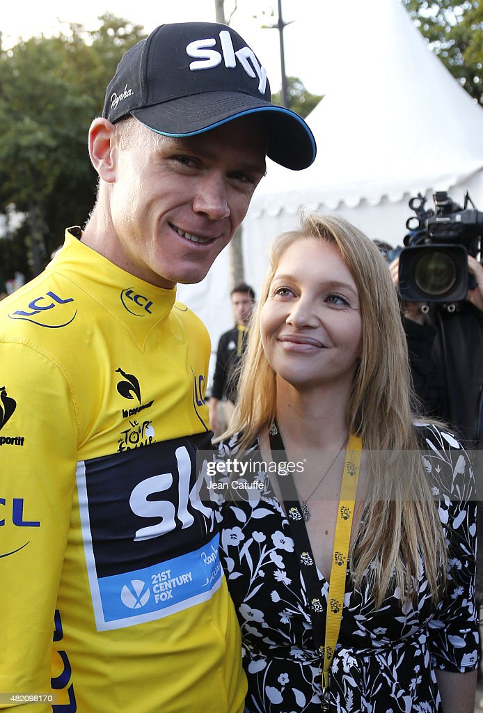 Chris Froome of Great Britain and Team Sky celebrates with his pregnant wife Michelle Cound winning the Tour de France 2015, following stage twenty one of the 2015 Tour de France, a 109.5 km stage from Sevres to the Champs Elysees Avenue in Paris on July 26, 2015 in Paris, France.
