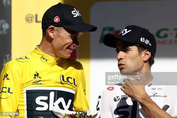 Chris Froome of Great Britain and Team Sky chats to team mate Mikel Landa of Spain after stage 14 of the 2017 Le Tour de France a 1815km stage from...