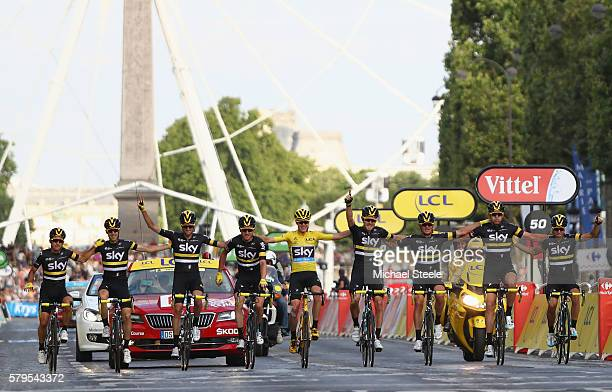 Chris Froome of Great Britain and Team Sky crosses the finishing line with the rest of Team Sky following victory during stage twenty one of the 2016...