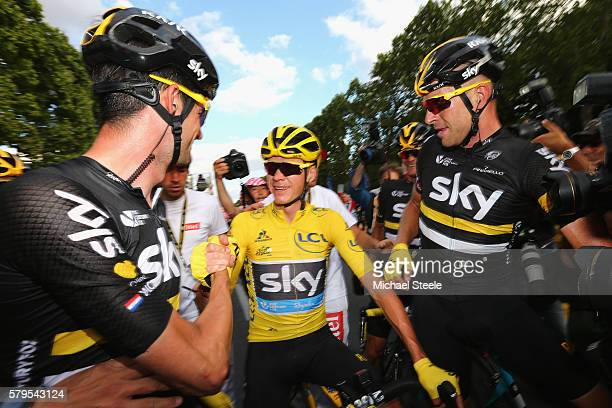 Chris Froome of Great Britain and Team Sky is congratulated by Wout Poels of the Netherlands and Team Sky and Ian Stannard of Great Britain and Team...