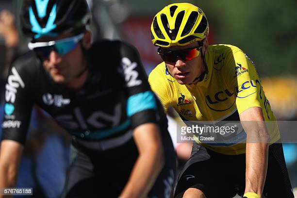 Chris Froome of Great Britain and Team Sky is guided over the finishing line by team mate Wouter Poels of Netherlands during the 160km stage15 of Le...
