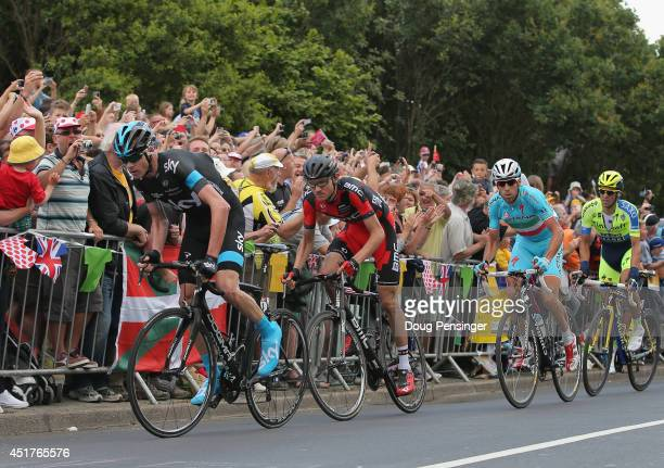 Chris Froome of Great Britain and Team Sky leads the race as he attacks on the final climb and claims the points at the top of the Cote de Jenkins...