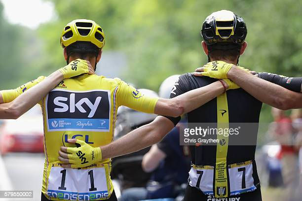 Chris Froome of Great Britain and Team Sky links arms wit Wout Poels of the Netherlands and Team Sky and Luke Rowe of Great Britain and Team Sky...