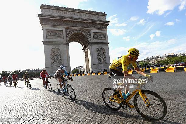 Chris Froome of Great Britain and Team Sky passes the Arc de Triomph on the first lap during stage twenty one of the 2016 Le Tour de France from...