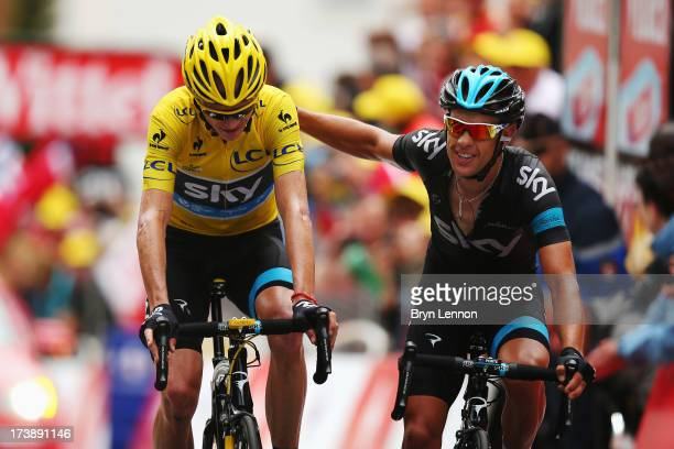 Chris Froome of Great Britain and Team Sky Procycling and team mate Richie Porte of Australia cross the finish line together at the end of stage...