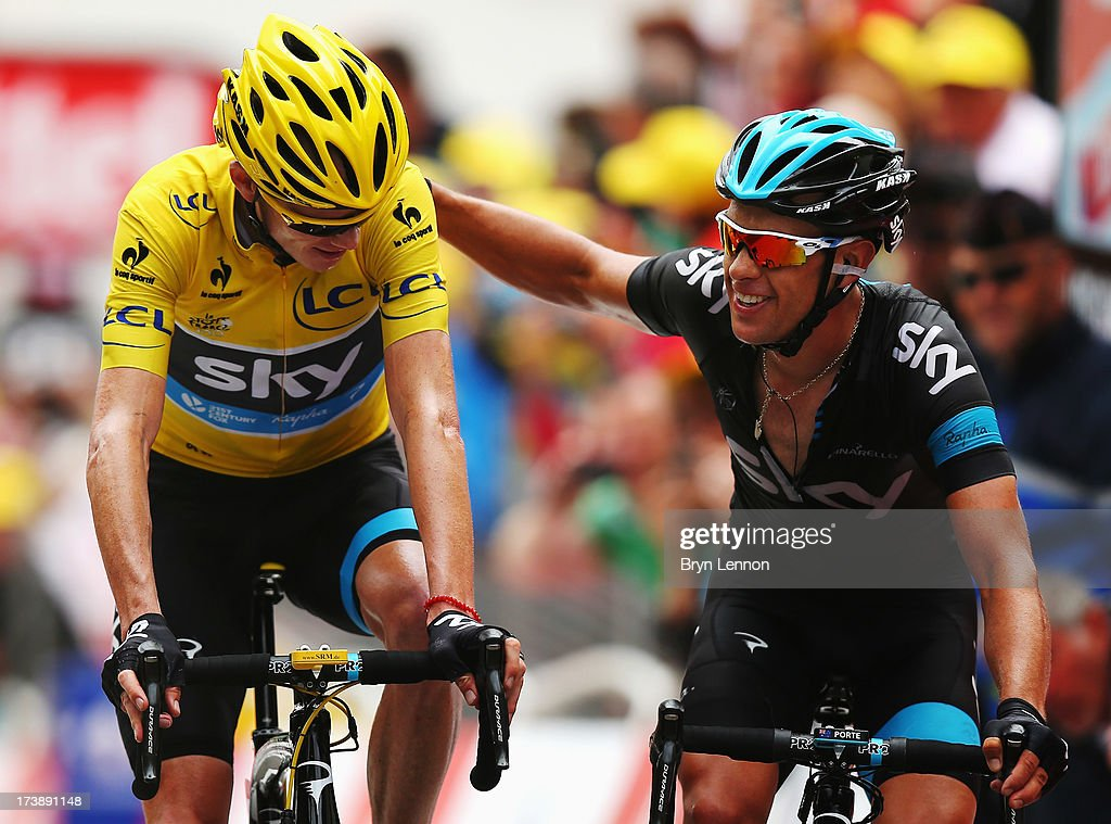 Chris Froome of Great Britain and Team Sky Procycling and team mate Richie Porte of Australia cross the finish line together at the end of stage eighteen of the 2013 Tour de France, a 172.5KM road stage from Gap to l'Alpe d'Huez, on July 18, 2013 in Alpe d'Huez, France.