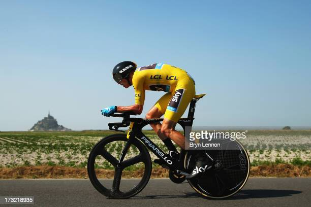 Chris Froome of Great Britain and Team Sky Procycling rides during stage eleven of the 2013 Tour de France, a 33KM Individual Time Trial from...