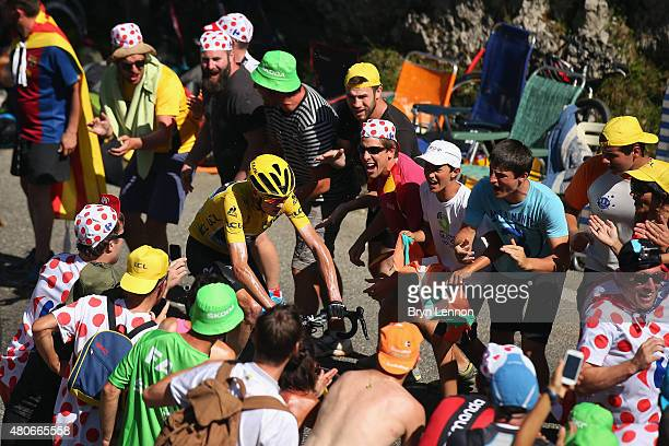 Chris Froome of Great Britain and Team Sky rides past fans as he climbs the Col de Soudet during stage ten of the 2015 Tour de France a 167 km stage...