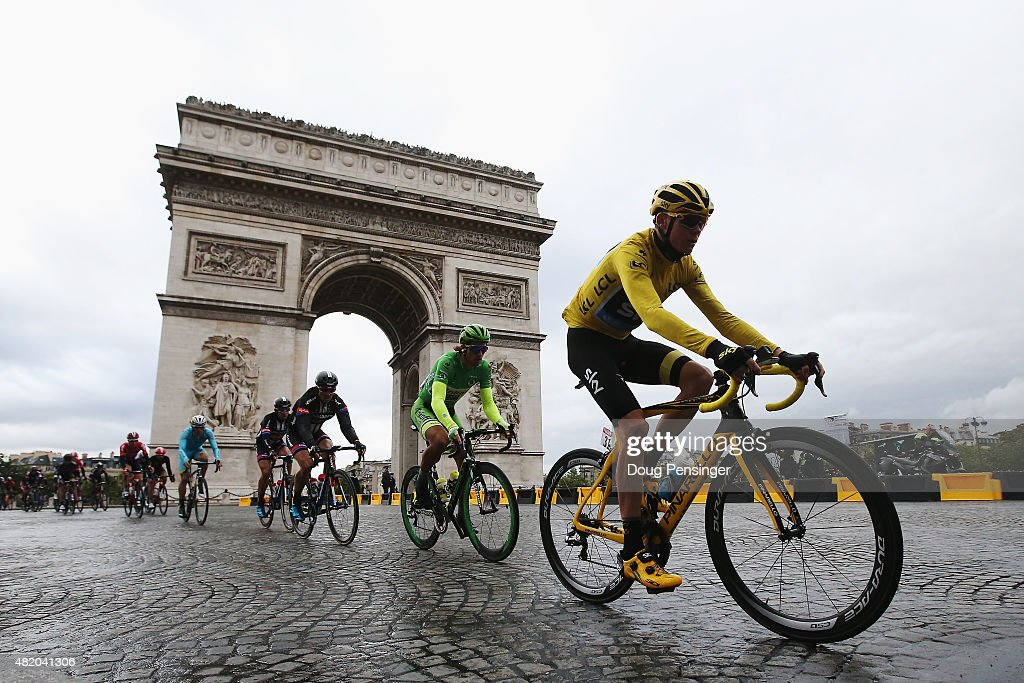Chris Froome (yellow jersey) of Great Britain and Team Sky rides past the Arc de Triomphe on his way to overall victory during the twenty first stage of the 2015 Tour de France, a 109.5 km stage between Sevres and Paris Champs-Elysees, on July 26, 2015 in Paris, France.