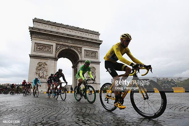 Chris Froome of Great Britain and Team Sky rides past the Arc de Triomphe on his way to overall victory during the twenty first stage of the 2015...
