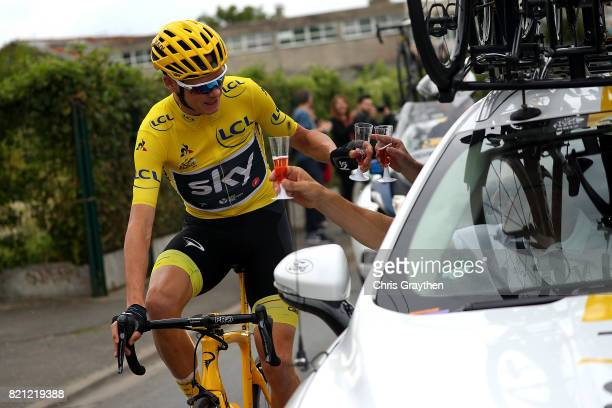 Chris Froome of Great Britain and Team Sky toasts a glass of champagne with his team during stage twenty one of Le Tour de France 2017 on July 23...