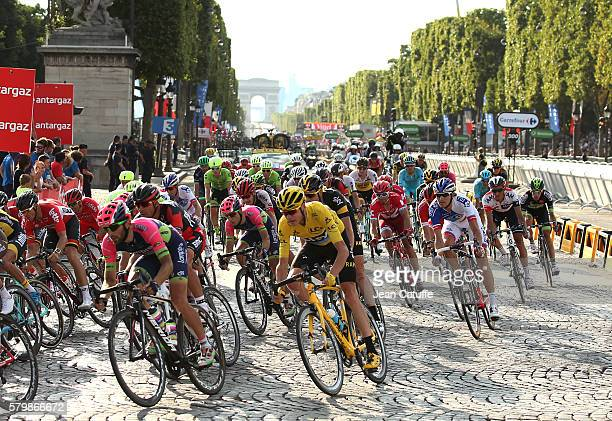 Chris Froome of Great Britain and Team Sky wearing the leader's yellow jersey rides among the pack during stage 21 last stage of the Tour de France...