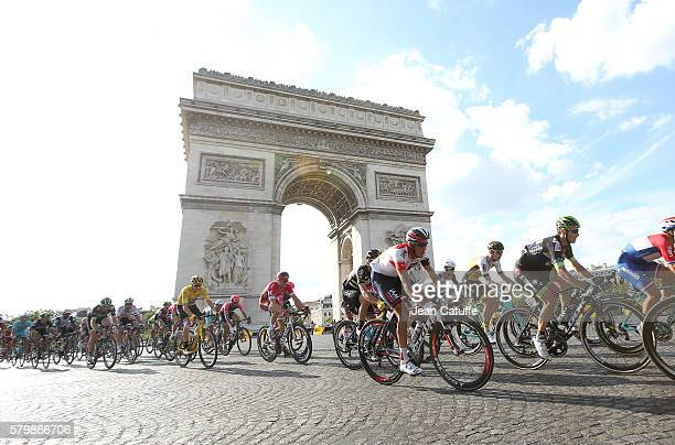 Chris Froome of Great Britain and Team Sky wearing the leader's yellow jersey rides among the pack in front of Arc de Triomphe during stage 21 last...