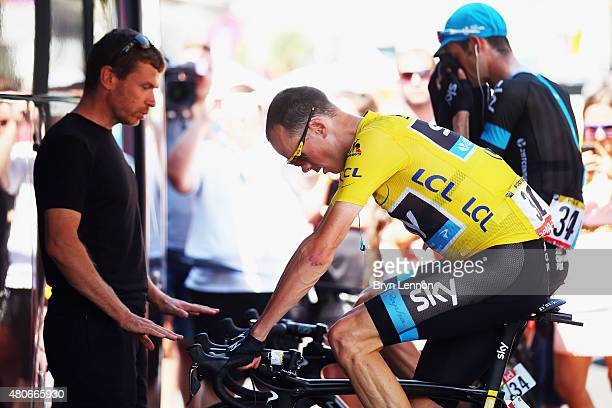Chris Froome of Great Britain and Team Sky wearing the overall leader's jersey prepares for the start of stage ten of the 2015 Tour de France a 167...