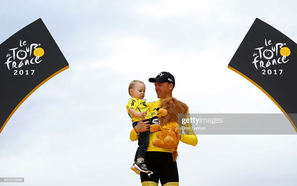 Chris Froome of Great Britain and Team Sky with his son, Kellan on the podium after winning the yellow jersey during stage twenty one of Le Tour de France 2017 on July 23, 2017 in Paris, France.