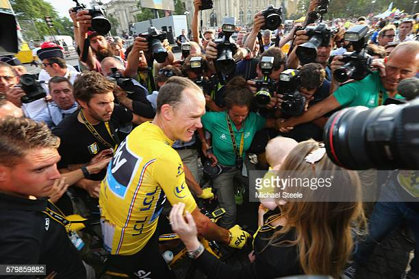 Chris Froome of Great Britain and Team Sky with his wife Michelle Froome and son Kellan following his overall GC victory during the 113km stage...