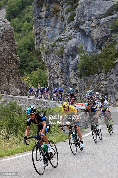 Chris Froome of Great Britain riding for Sky Procycling defends the overall race leader's yellow jersey as the peloton passes through the Gorges de...