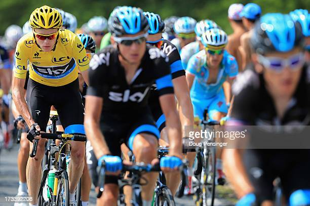 Chris Froome of Great Britain riding for Sky Procycling is protected by his teammates as he defends the overall race leader's yellow jersey during...