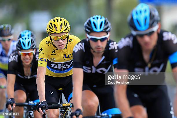 Chris Froome of Great Britain riding for Sky Procycling is protected by his team as he defends the overall race leader's jersey during stage sixteen...