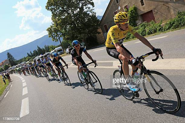 Chris Froome of Great Britain riding for Sky Procycling rides in the peloton as he defends he overall race leader's jersey during stage sixteen of...