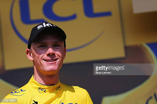 Chris Froome of Great Britain riding for Sky Procycling takes the podium after defending the overall race leader's yellow jersey during stage eleven...