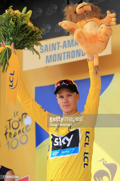 Chris Froome of Great Britain riding for Sky Procycling takes the podium after defending the overall race leader's yellow jersey during stage...