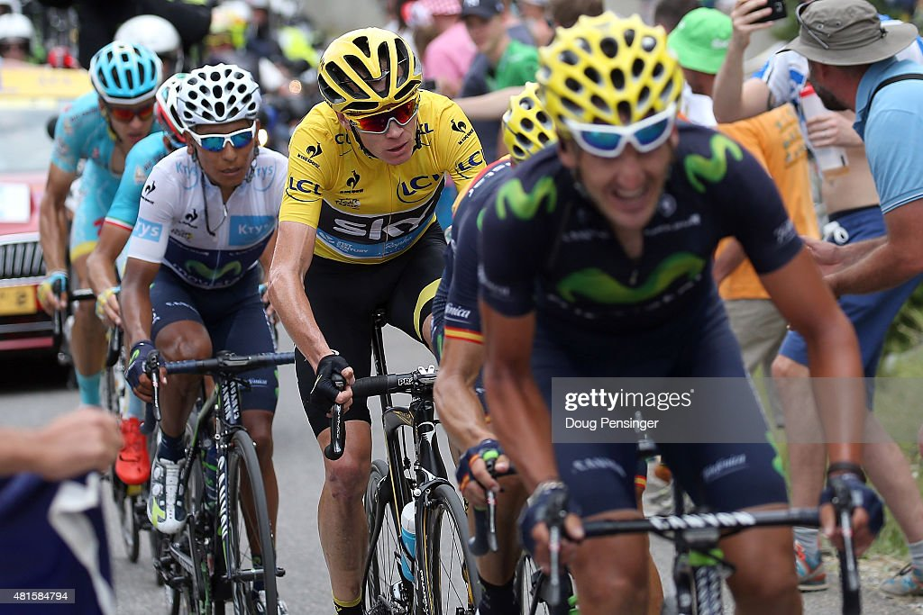 Chris Froome (C) of Great Britain riding for Team Sky defends the overall race leader yellow jersey against Nairo Quintana (L) of Columbia riding for Movistar Team in the best young rider white jersey as he gets help from teammate Gorka Izagirre (R) of Spain riding for Movistar Team on the climb to the finish of stage 17 of the 2015 Tour de France from Digne-Les-Bains to Pra Loup on July 22, 2015 in Pra Loup, France.