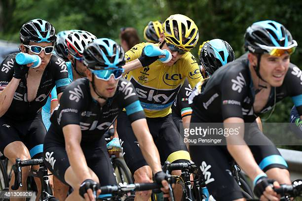 Chris Froome of Great Britain riding for Team Sky in the overall race leader yellow jersey takes a drink along with teammate Geraint Thomas of Great...