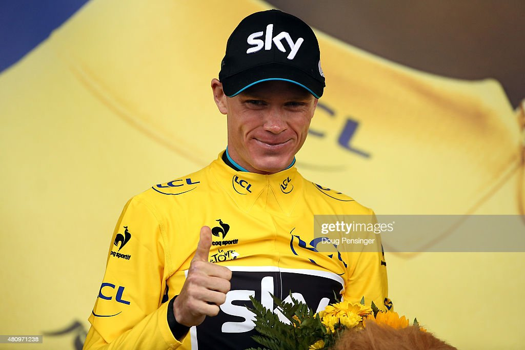 Chris Froome of Great Britain riding for Team Sky takes the podium after defending the overall race leaders yellow jersey in stage 12 of the 2015 Tour de France from Lannemezan to Plateau de Belle on July 16, 2015 in Plateau de Beille, France.