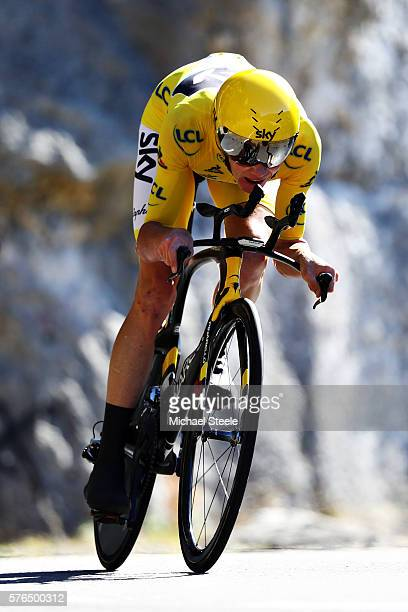 Chris Froome of Great Britain riding for Team Sky wearing the yellow leaders jersey rides on the individual time trial during stage thirteen of the...