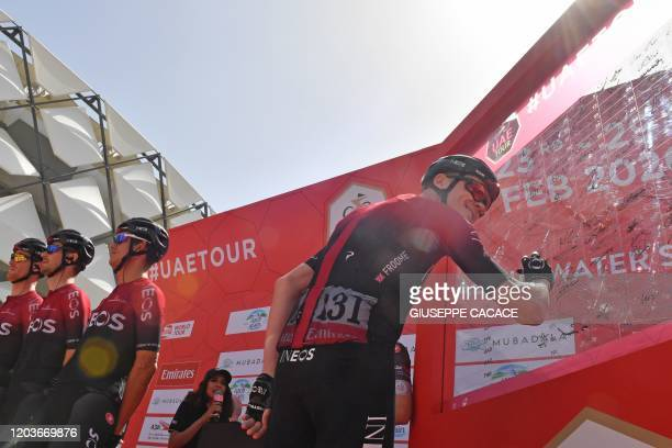 Chris Froome of Team Ineos signs his autograph ahead of the 5th stage of the UAE Cycling Tour from alAin to Jebel Hafeet on February 27 2020