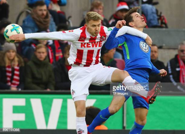 Chris Fuehrich of Koeln and Paul Verhaegh of Wolfsburg battle for the ball during the Bundesliga match between 1 FC Koeln and VfL Wolfsburg at...