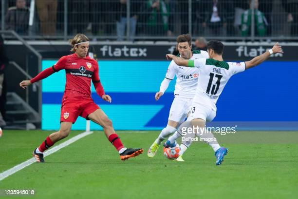 Chris Fuehrich of VfB Stuttgart, Joe Scally of Borussia Moenchengladbach and Lars Stindl of Borussia Moenchengladbach battle for the ball during the...