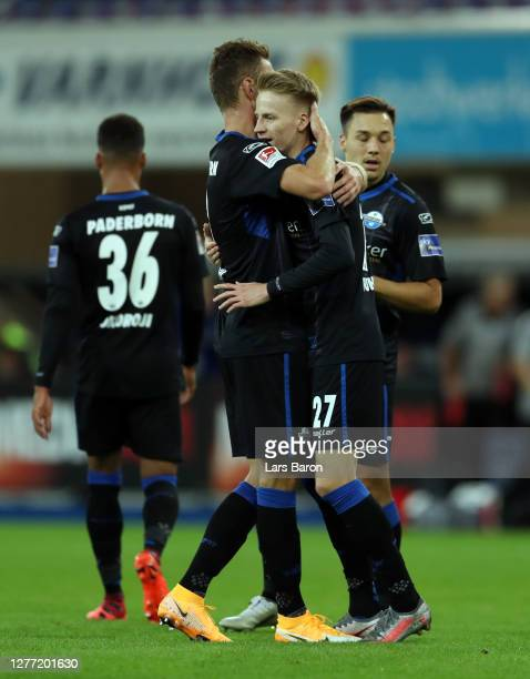 Chris Fuhrich of SC Paderborn 07 celebrates with teammates after scoring his sides second goal during the Second Bundesliga match between SC...