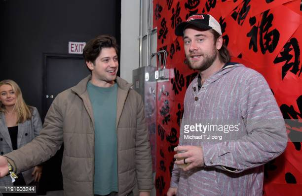 Chris Galya and Luke Benward attend the VIP opening night for the Dumpling Associates popup art exhibition at ROW DTLA on December 02 2019 in Los...