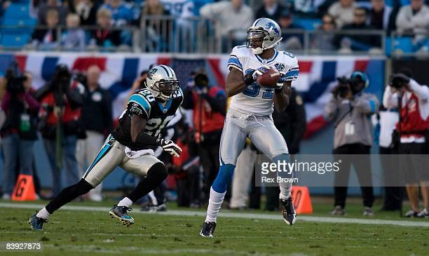 Chris Gamble of the Carolina Panthers defends as Calvin Johnson of the Detroit Lions makes a reception at Bank of America Stadium on November 16,...