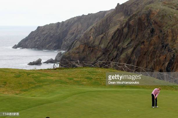 Chris Gane of England hits his third shot on the 13th green during day three of the Madeira Islands Open on May 21 2011 in Porto Santo Island Portugal