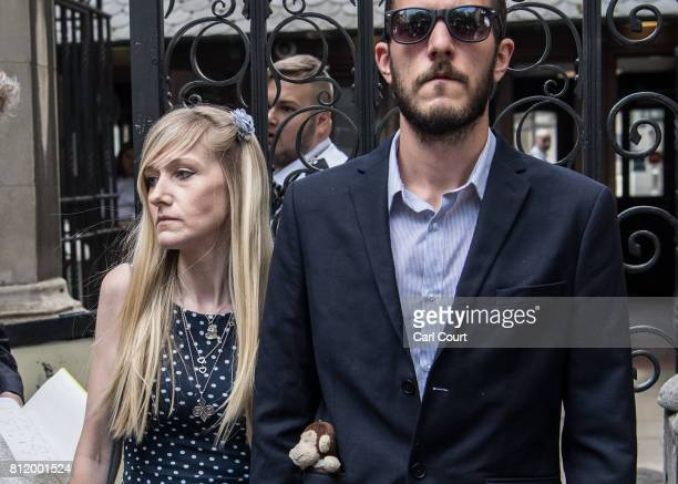 Chris Gard and Connie Yates the parents of terminally ill toddler Charlie Gard listen as a family friend addresses the media outside High Court on...