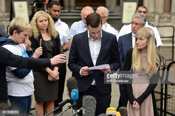 Chris Gard the father of terminallyill 11monthold Charlie Gard reads out a statement while Charlie's mother Connie Yates looks on at the Royal Courts...