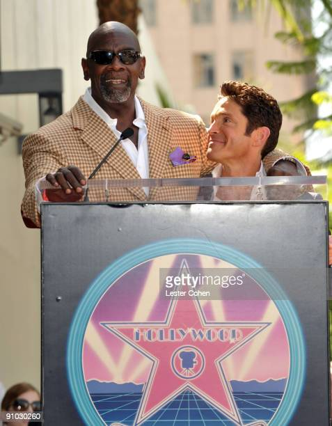 Chris Gardner greets Musician Dave Koz as Koz is honored with a star on the Hollywood Walk Of Fame on September 22 2009 in Hollywood California