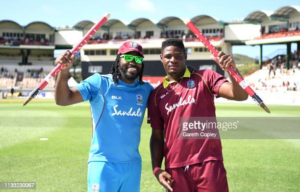 Chris Gayle and Oshane Thomas of the West Indies celebrate winning the Fifth One Day International match between England and West Indies at Darren...