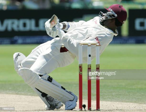 Chris Gayle ducks a bouncer from Dale Steyn during Day 3 of the 1st Test match between South Africa and West Indies at the Sahara Oval, St Georges...