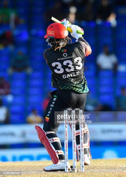 Chris Gayle of Saint Kitts & Nevis Patriots bat broke during the 2021 Hero Caribbean Premier League Play-Off match 32 between Guyana Amazon Warriors...