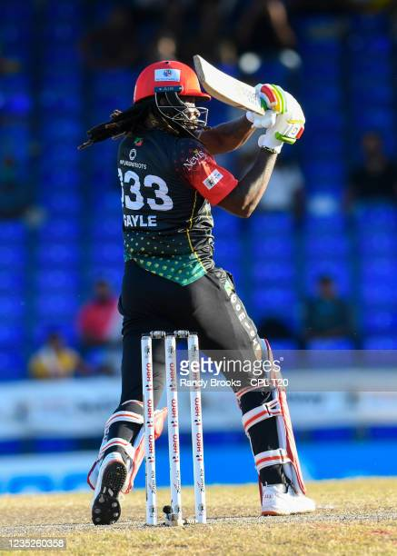 Chris Gayle of Saint Kitts & Nevis Patriots hits 4 during the 2021 Hero Caribbean Premier League Play-Off match 32 between Guyana Amazon Warriors and...