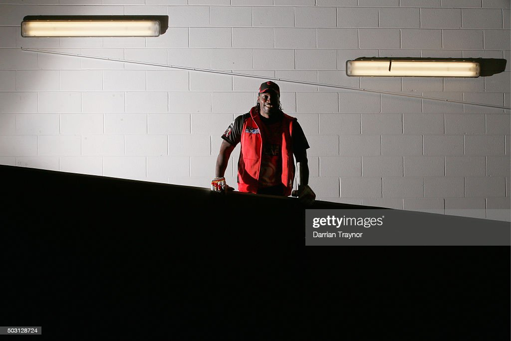 Chris Gayle of the Melbourne Renegades stops for a photo as he walks up the players race to warm up before the Big Bash League match between the Melbourne Stars and the Melbourne Renegades at Melbourne Cricket Ground on January 2, 2016 in Melbourne, Australia.