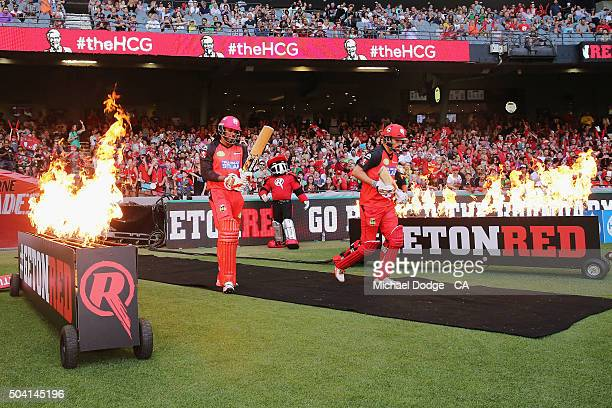 Chris Gayle of the Renegades and Tom Cooper of the Renegades come out to bat during the Big Bash League match between the Melbourne Renegades and the...