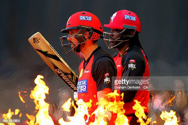 Chris Gayle of the Renegades and Tom Cooper of the Renegades walk onto the field to bat during the Big Bash League match between the Melbourne...
