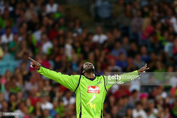 Chris Gayle of the Thunder celebrates taking the wicket of Moises Henriques of the Sixers during the Big Bash League match between Sydney Thunder and...